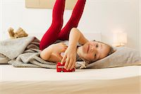 Smiling girl playing with toy bus in bed Stock Photo - Premium Royalty-Freenull, Code: 6122-07703519