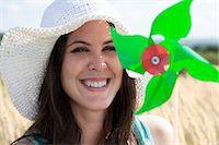 Woman holding pinwheel in wheatfield Stock Photo - Premium Royalty-Freenull, Code: 6122-07703528