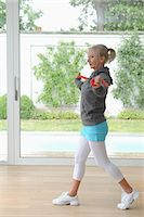 fit people - Older woman using exercise band at home Stock Photo - Premium Royalty-Freenull, Code: 6122-07703694