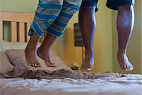 Couples feet jumping on bed Stock Photo - Premium Royalty-Freenull, Code: 6122-07704064