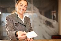 Hotel concierge with card at desk Stock Photo - Premium Royalty-Freenull, Code: 6122-07704474