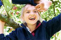 female feet close up - Smiling children climbing tree together Stock Photo - Premium Royalty-Freenull, Code: 6122-07704848