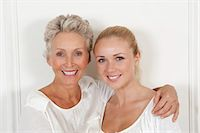 Mother and daughter smiling together Stock Photo - Premium Royalty-Freenull, Code: 6122-07704940