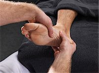 foot massage - Close up of man having foot massage Stock Photo - Premium Royalty-Freenull, Code: 6122-07705272