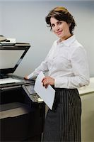 Businesswoman making copies in office Stock Photo - Premium Royalty-Freenull, Code: 6122-07705738