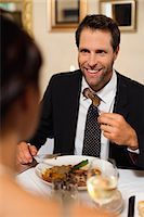 Couple having dinner in restaurant Stock Photo - Premium Royalty-Freenull, Code: 6122-07706202