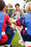 Coach talking to childrens soccer team Stock Photo - Premium Royalty-Freenull, Code: 6122-07706209