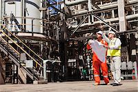 refinery - Workers talking at oil refinery Stock Photo - Premium Royalty-Freenull, Code: 6122-07706231