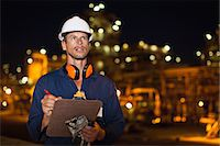 refinery - Worker with clipboard at oil refinery Stock Photo - Premium Royalty-Freenull, Code: 6122-07706268
