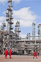 refinery - Workers talking at oil refinery Stock Photo - Premium Royalty-Freenull, Code: 6122-07706269