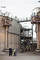 refinery - Workers talking at chemical plant Stock Photo - Premium Royalty-Freenull, Code: 6122-07706317