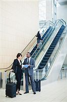 Business people talking in lobby Stock Photo - Premium Royalty-Freenull, Code: 6122-07706325