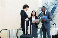 Business people talking in lobby Stock Photo - Premium Royalty-Freenull, Code: 6122-07706326