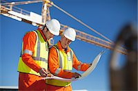 Workers reading blueprints on site Stock Photo - Premium Royalty-Freenull, Code: 6122-07706352