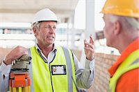 person holding sign - Workers talking at construction site Stock Photo - Premium Royalty-Freenull, Code: 6122-07706360
