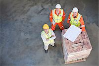 partnership - Workers reading blueprints on site Stock Photo - Premium Royalty-Freenull, Code: 6122-07706374