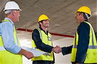 partnership - Workers shaking hands on site Stock Photo - Premium Royalty-Freenull, Code: 6122-07706385
