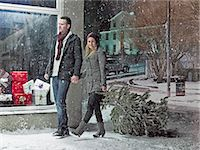 snow christmas tree white - Couple carrying Christmas tree in snow Stock Photo - Premium Royalty-Freenull, Code: 6122-07706505