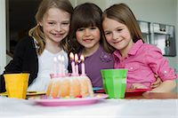 Smiling girls hugging at birthday party Stock Photo - Premium Royalty-Freenull, Code: 6122-07706686