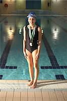 preteen swim - Swimmer wearing medals by pool Stock Photo - Premium Royalty-Freenull, Code: 6122-07706707