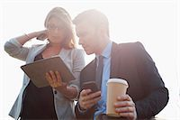 Businesspeople using tablet computer Stock Photo - Premium Royalty-Freenull, Code: 6122-07707420
