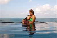 Mother and daughter in infinity pool Stock Photo - Premium Royalty-Freenull, Code: 6122-07707458