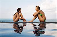 Mother and daughter at edge of pool Stock Photo - Premium Royalty-Freenull, Code: 6122-07707459