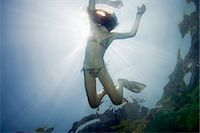 Girl snorkeling in tropical waters Stock Photo - Premium Royalty-Freenull, Code: 6122-07707469