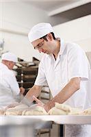 Chef baking in kitchen Stock Photo - Premium Royalty-Freenull, Code: 6122-07707495