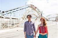 Portrait of couple with blank expressions at amusement park Stock Photo - Premium Royalty-Freenull, Code: 614-07708166