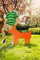 Young Boy Holding Cardboard Cut Out in Shape of Dog Stock Photo - Premium Rights-Managed, Artist: ableimages, Code: 822-07708439