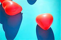 Red Heart Shaped Party Balloons on Blue Background Stock Photo - Premium Rights-Managed, Artist: ableimages, Code: 822-07708669