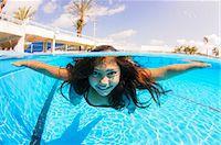 preteen swim - Girl free diving under water in swimming pool Stock Photo - Premium Royalty-Freenull, Code: 649-07710109