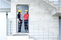 Businesswomen in safety helmet at balcony Stock Photo - Premium Royalty-Freenull, Code: 649-07710139
