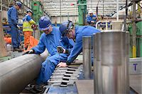 people working in factory - Engineers working on turbine housing repair during power station outage Stock Photo - Premium Royalty-Freenull, Code: 649-07710161