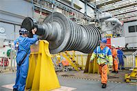 supervising - Banksman and crane operator lowering crane to turbine hall during power station outage Stock Photo - Premium Royalty-Freenull, Code: 649-07710174