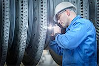 people working in factory - Engineer with torch inspecting turbine during power station outage Stock Photo - Premium Royalty-Freenull, Code: 649-07710178