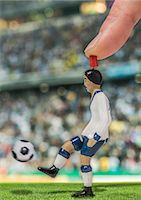 footballeur - Digitally generated image of soccer player kicking ball in stadium Stock Photo - Premium Royalty-Freenull, Code: 649-07710195