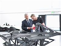 Manager and engineer inspecting carbon fibre body of supercar in sports car factory Stock Photo - Premium Royalty-Freenull, Code: 649-07710223