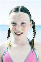 preteen bathing suit - Close up portrait of girl with pigtails at coast Stock Photo - Premium Royalty-Freenull, Code: 649-07710261