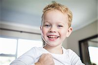 Portrait of smiling three year old boy Stock Photo - Premium Royalty-Freenull, Code: 649-07710651
