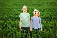 preteen girl pigtails - Portrait of nine year old girl and sister holding hands in field Stock Photo - Premium Royalty-Freenull, Code: 649-07710663