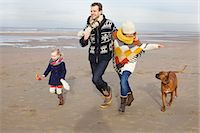 dog and woman and love - Mid adult parents, daughter and dog running on beach, Bloemendaal aan Zee, Netherlands Stock Photo - Premium Royalty-Freenull, Code: 649-077