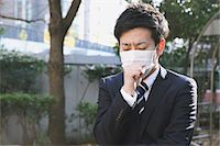 people coughing or sneezing - Sick Japanese young businessman in a suit at the park Stock Photo - Premium Rights-Managed, Artist: Aflo Relax, Code: 859-07711104