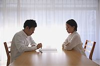 stamping (all meanings) - Young Japanese couple signing divorce papers Stock Photo - Premium Rights-Managed, Artist: Aflo Relax, Code: 859-07711155