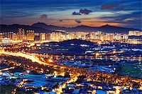 Famed skyline of Hong Kong  Yuen Long downtown sunset Stock Photo - Royalty-Freenull, Code: 400-07716712
