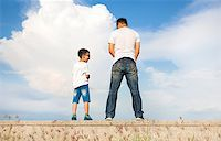 father and son standing on a stone platform and pee together Stock Photo - Royalty-Freenull, Code: 400-07720000