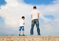 father and son standing on a stone platform and pee together Stock Photo - Royalty-Freenull, Code: 400-07720007