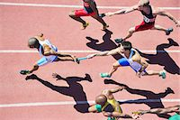 runner (male) - Relay runners passing batons on track Stock Photo - Premium Royalty-Freenull, Code: 6113-07730464