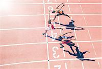 finish line - Runners crossing finish line on track Stock Photo - Premium Royalty-Freenull, Code: 6113-07730469